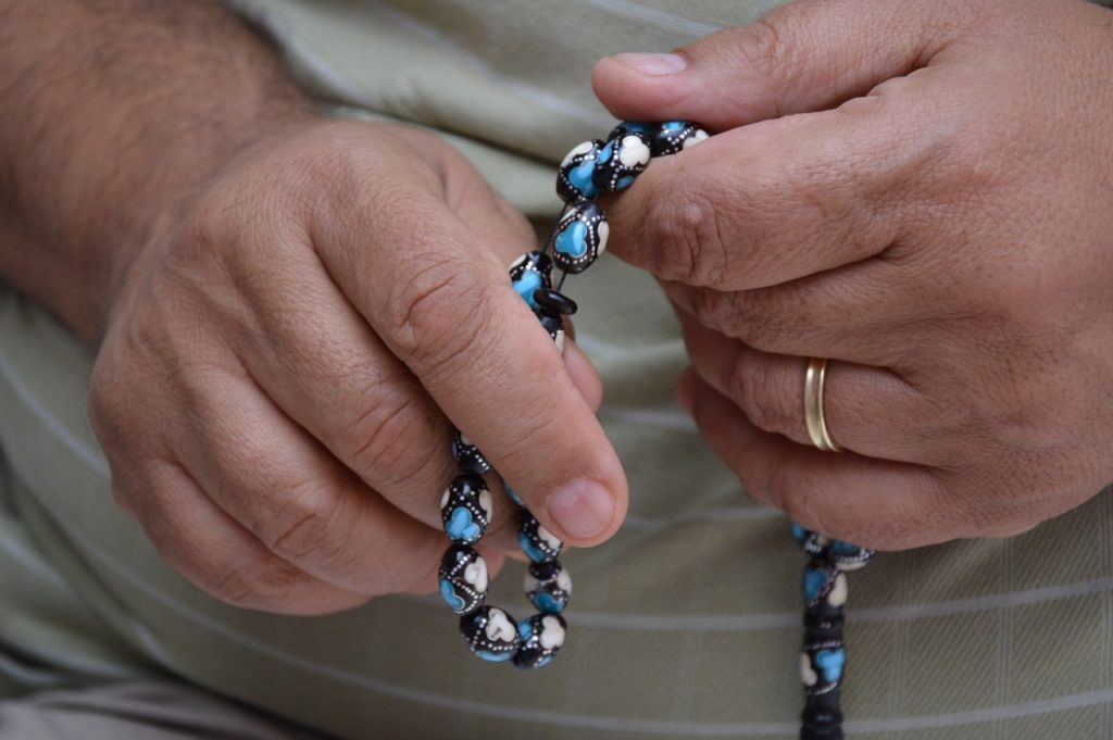 Hands with praying beads